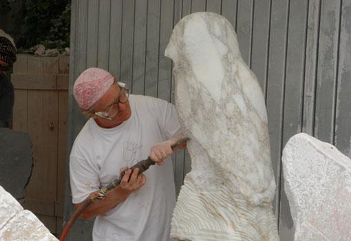 sculptor michael binkley carving a marble sculpture